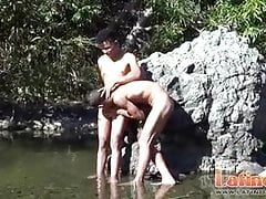 Nude ethnic gay boys romping under the torrid sun